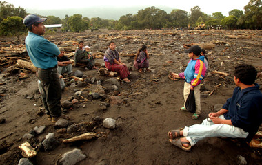 Maya Indian family sits amidst destruction left by mudslide in Guatemala's village of Panabaj