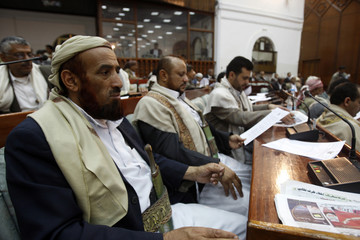 Members of Yemen's House of Deputies attend a house session in Sanaa
