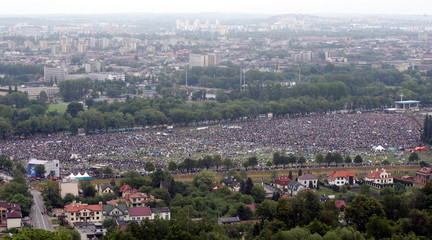 People attend a mass with Pope Benedict XVI in Krakow