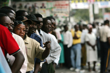 Thousands of voters wait in line outside at High School of Petionville in Port-au-Prince