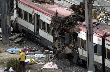 DESTROYED TRAIN OUTSIDE MADRID'S ATOCHA STATION.