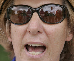 Reporters are reflected in anti-war activist Sheehan's sunglasses during protest outside U.S. President Bush's ranch in Texas