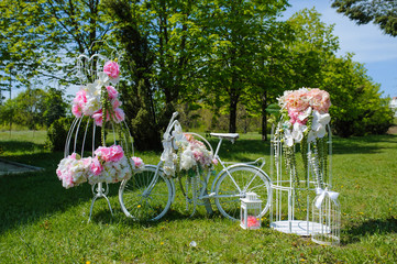 Wedding composition with white bicycle