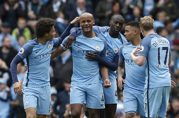 Manchester City's Vincent Kompany celebrates scoring their second goal with team mates
