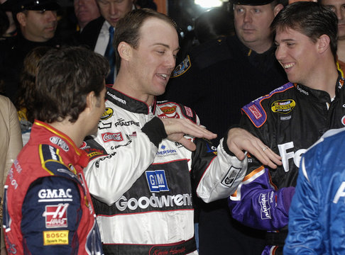 Harvick shares a laugh with fellow drivers Hamlin and Gordon after the top ten NASCAR drivers celebrated the end of their season with a lap through Times Square in New York