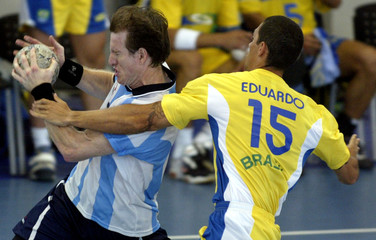 KOGOSEK OF ARGENTINA AGAINST REIS OF BRAZIL AT THE PAN AMERICAN GAMES.