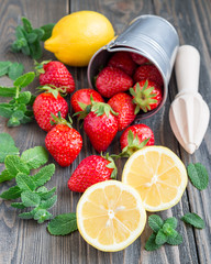 Ingredients for homemade strawberry lemonade on wooden table, vertical