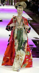 A model  presents this creation by French designer Christian Lacroix for his fashion show at the 200..