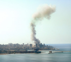 Smoke billows into the sky over the city following a car bomb explosion in Beirut.