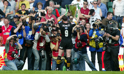 London Wasps wining try scorer Rob Howley poses for pictures as he lifts the trophy after winning th..