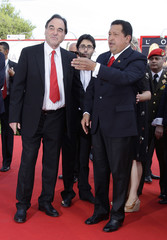 U.S. film director Stone and Venezuela's President Chavez pose for photographers during a red carpet at the 66th Venice Film Festival