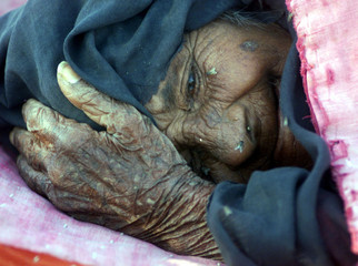 AN INDIAN WOMAN LIES IN THE VILLAGE OF KALITALABADI.
