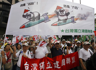 Demonstrators shout slogans during an anti-China protest along the Zhongxiao area in Taiwan