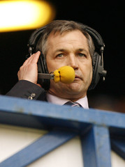 Scotland's new soccer manager George Burley watches the Rangers during their Scottish Premier League match against St. Mirren at the Ibrox stadium