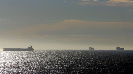 Ships anchor close to coast while waiting to enter port of Newcastle.