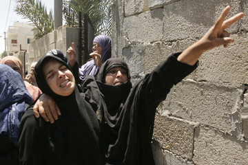 Palestinian relatives of Yosra Abu Roak, 65, mourn during her funeral in Khan Younis southern Gaza Strip