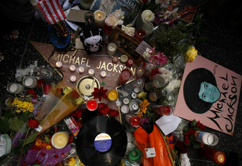 Fans make a shrine for the late pop star Michael Jackson on his star on the Hollywood Walk of Fame in Los Angeles