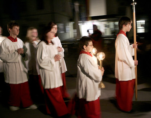 Altar boys march with candles while celebrating the 80th birthday of Pope Benedict XVI at his birthplace in Marktl