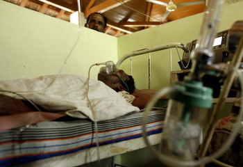 D.K. Senawirathna, a victim of a passenger bus explosion, receives treatment at a hospital in Dambulla