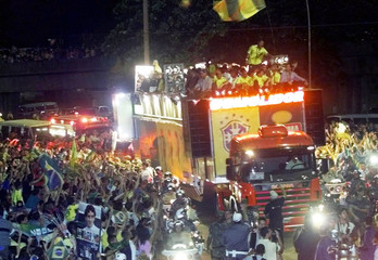 Members of Brazilian soccer national team celebrate in Rio de Janeiro, July 2, 2002. The team return..