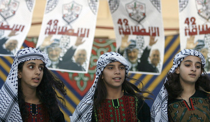 Palestinian supporters of Fatah take part in a rally near Ramallah