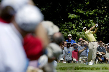 Spectators lean in to catch a glimpse of the U.S. golfer Woods as he tees off on 13th hole during second round play at the 2007 US Open Championship golf tournament in Oakmont