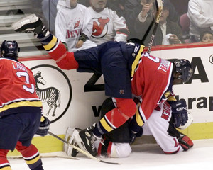 PANTHERS WORRELL CRASHES INTO DEVILS MADDEN IN NHL GAME.