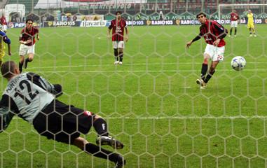 AC Milan's Kaka scores against Chievo during Italian Serie A soccer match in Milan