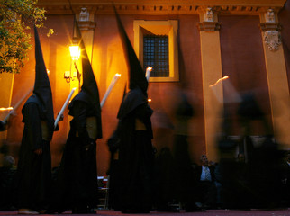 Penitents take part in procession of El Gran Poder brotherhood during Holy Week in Seville