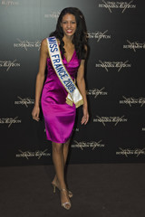 """Miss France 2009 Chloe Mortaud poses for photographers as she arrives for the premiere of """"The Curious Case of Benjamin Button"""" in Paris"""