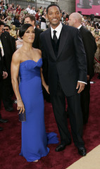 Actor Smith and husband actor Smith arrive for the 78th annual Academy Awards in Hollywood