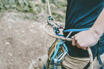 Climber belaying with figure eight.