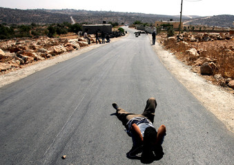 Palestinian man takes rest during protest in Bilin.