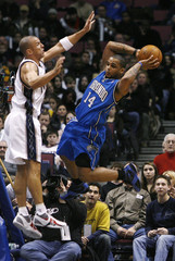 Orlando Magic's Nelson passes in front of New Jersey Nets' Kidd in East Rutherford