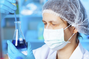 Woman holding flask in chemical laboratory