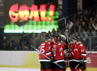 Swiss players celebrate the game winning goal by Mark Streit against the Czech Republic at the Torino 2006 Winter Olympic Games in Turin