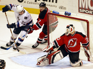 VANCOUVER CANUCKS BOUCK FOILED BY NEW JERSEY DEVILS MARTIN.