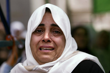PALESTINIAN WOMAN CRIES DURING WALEED ASHOUR FUNERAL IN GAZA.