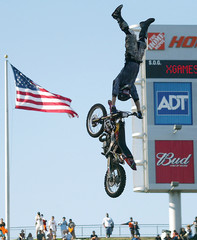 Adam Jones flys high during Dirt Bike and Motorcycle finals at the X-Games competition in Los Angeles.