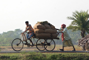 File photo of farmers transporting their produce to a market in Nandigram village