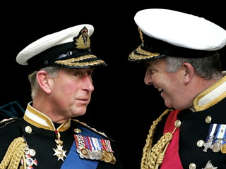 Britain's Prince Charles (L) speaks to The First Sea Lord, Admiral Sir Alan West, as they leave St P..
