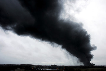 Smoke continues to billow for a second day after an explosion at a fuel depot in Hemel Hempstead in central England