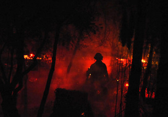 A firefighter works to contain a wild fire in Santa Barbara