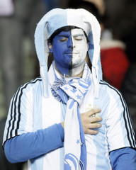 An Argentinian supporter gestures during a friendly soccer match against Catalunya in Barcelona