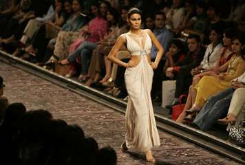A model presents a creation by Indian designer Tahiliani at a fashion show in New Delhi