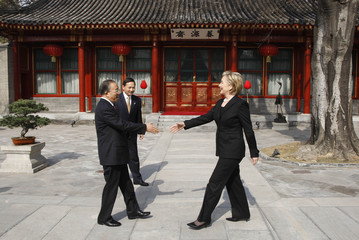 U.S. Secretary of State Clinton is greeted by Chinese State Councillor Dai Bingguo in Beijing