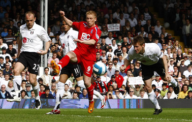 Fulham's McBride heads and scores past Birmingham City's Forssell during their English Premier League soccer match in London