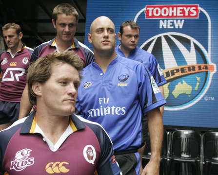 Rugby players Latham, McMeniman and Flatley of the Queensland Reds leave the stage during the official launch of the Super 14 rugby season in central Sydney
