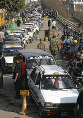 Motorists in cars and bikes line up to purchase fuel in the Nepali capital Kathmandu