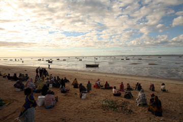 Women wait for fishermen to return with their catch in Costa do Sol, Maputo